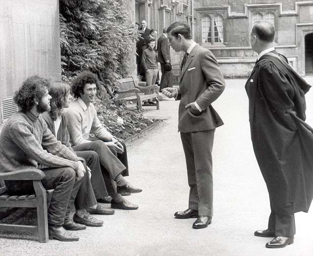 Prince Charles talking to students on a bench