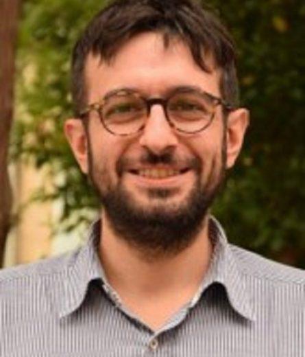 Man in glasses smiling George Deligiannidis